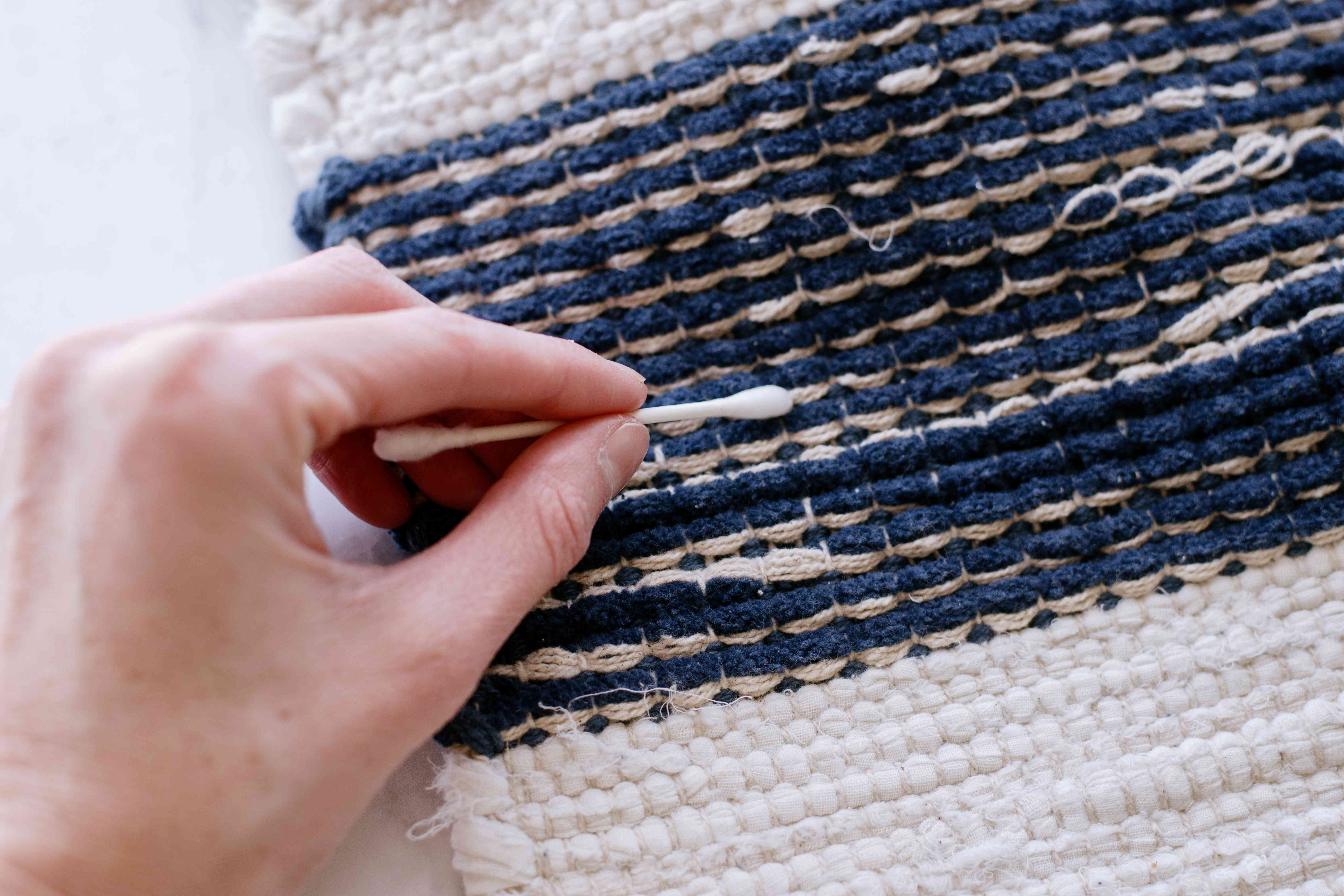 Throw rug rubbed by cotton swab closeup