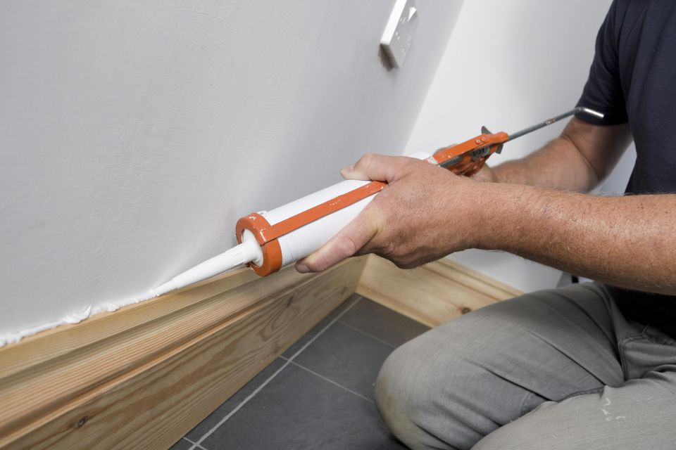 How to repair gapping baseboards - Wood filler or caulk for exterior trim ...