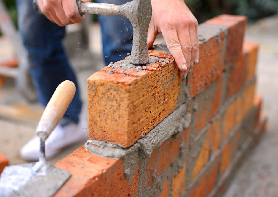 Laying brick foundation