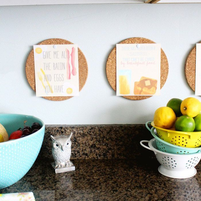 Mini cork board bulletin boards hanging in a kitchen