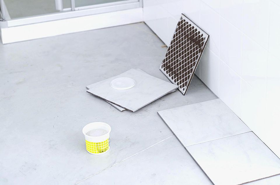 High angle view of a room floor being tiled