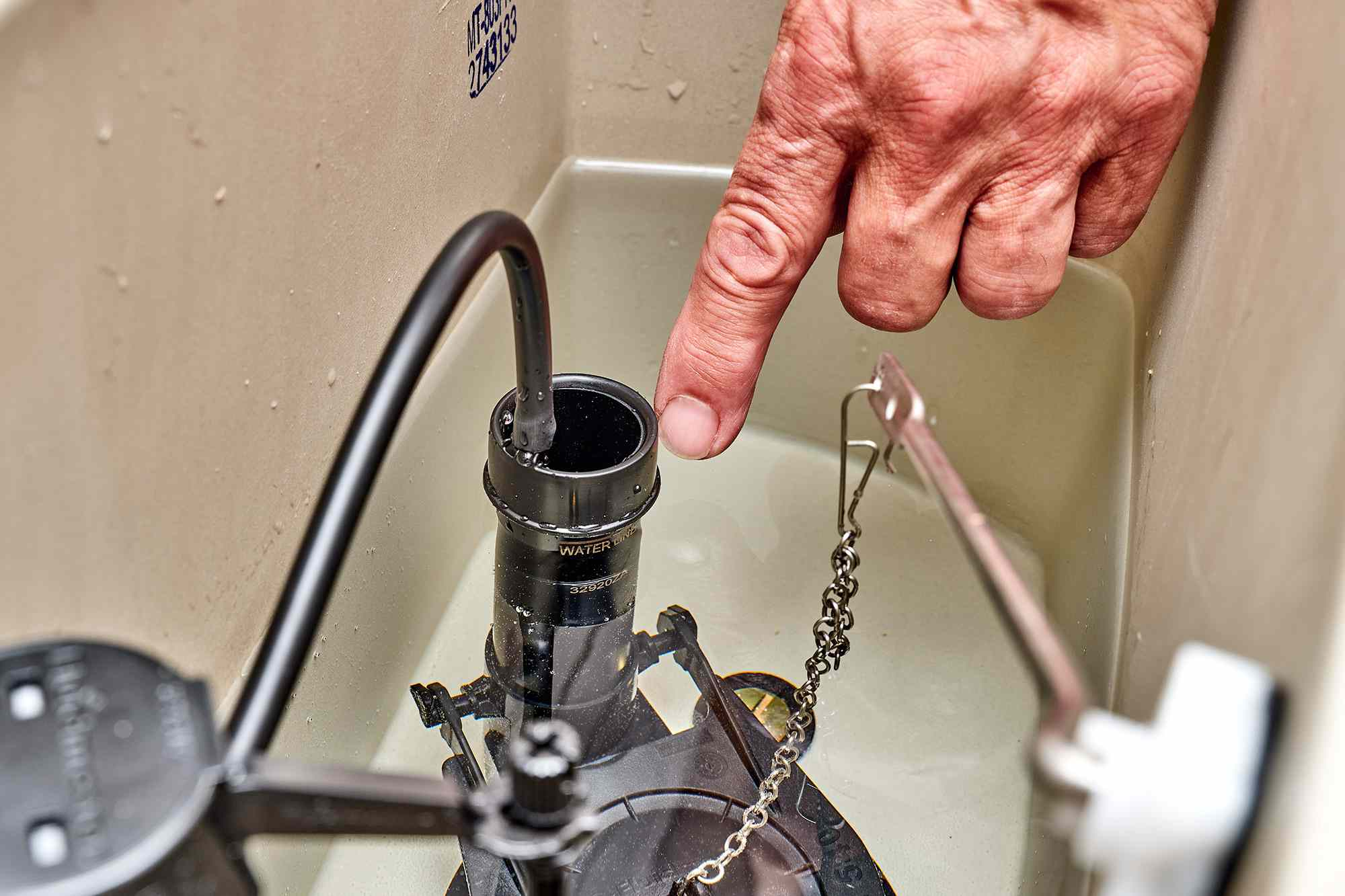 Water level being monitored for level mark on float-cup fill valve