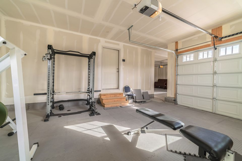 Assorted gym and fitness equipment in a garage