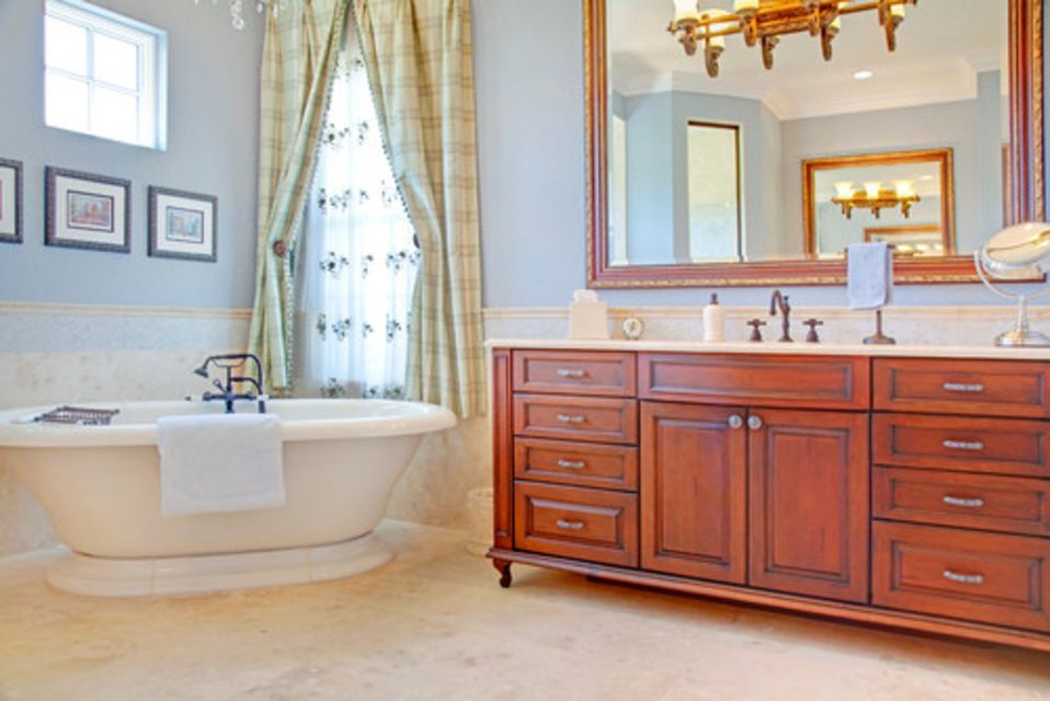 french country bathroom with wood