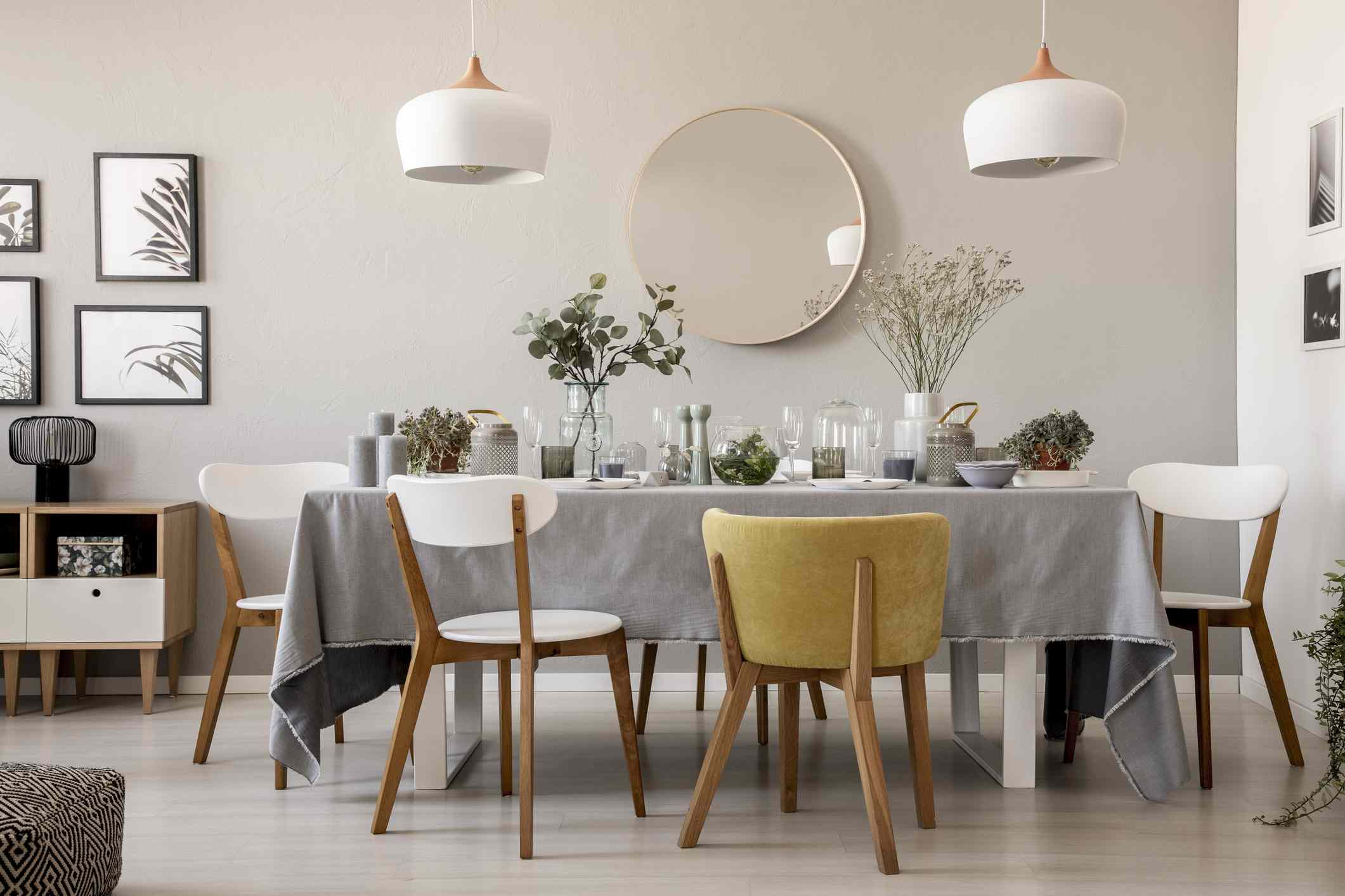 Gray dining room with chairs, lighting and neutral colors