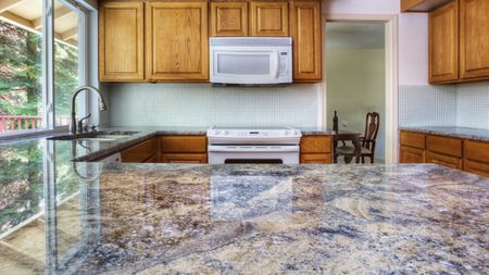 Granite Counter Reflecting Kitchen Cabinets