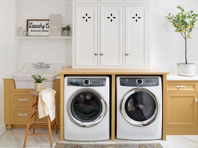 Lovely retro inspired yellow laundry room