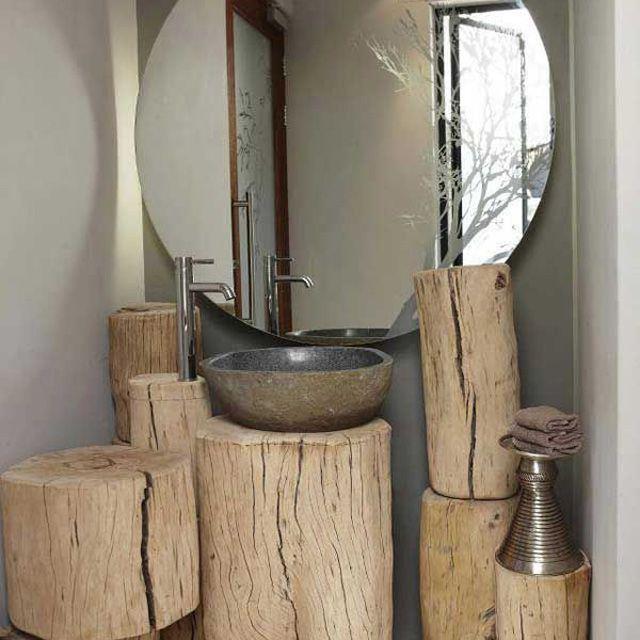 Bathroom with wood stump vanity space