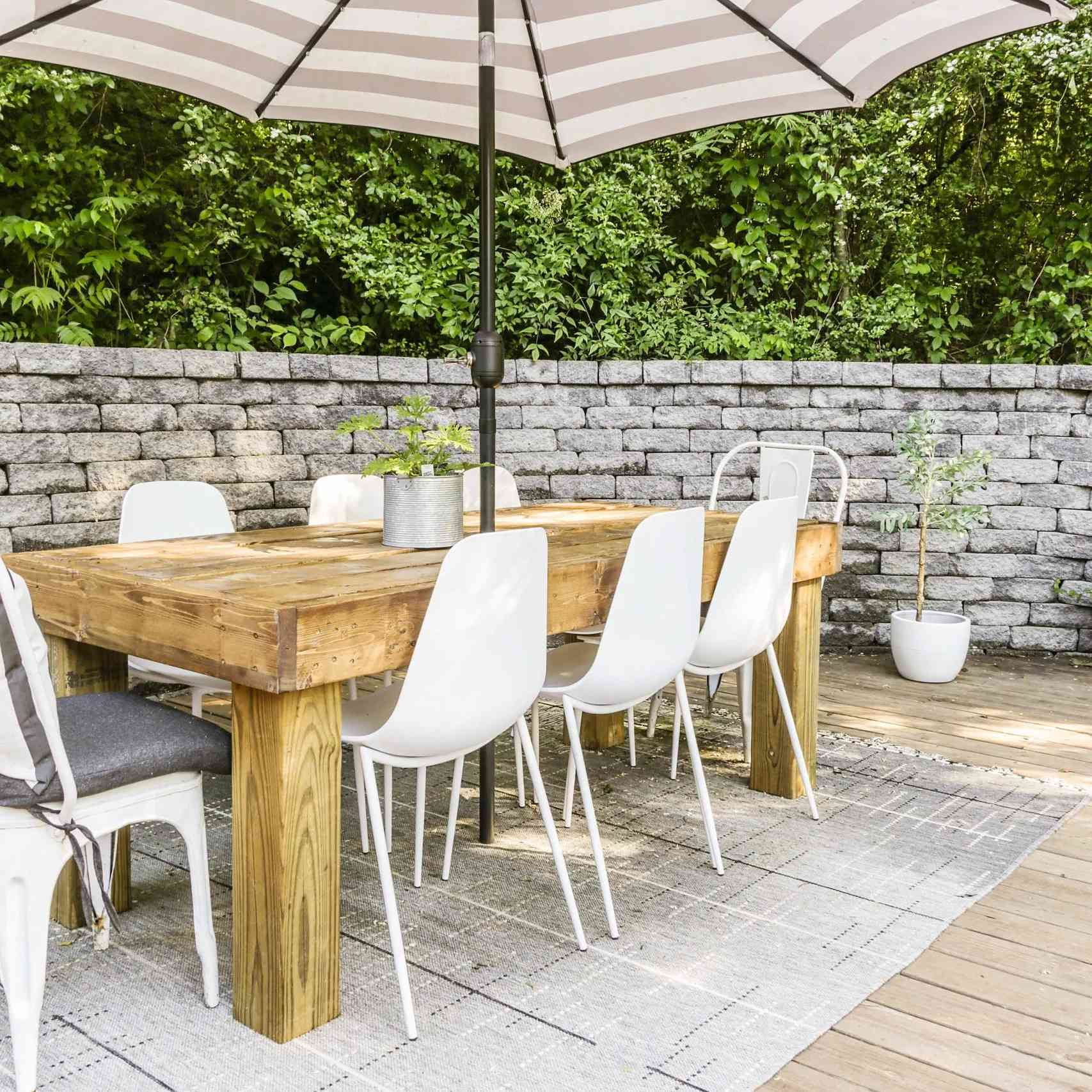 An outdoor dining table with a patio umbrella