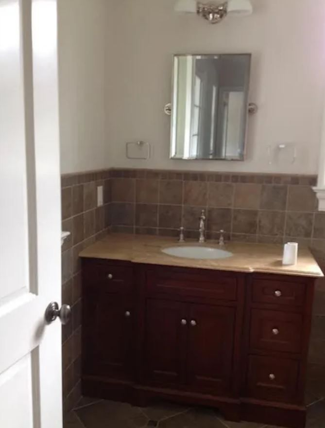 Old bathroom with brown details.