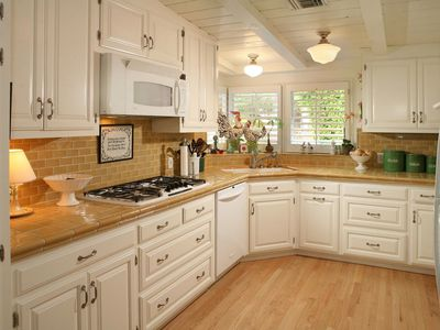 white and gold kitchen with tile countertop
