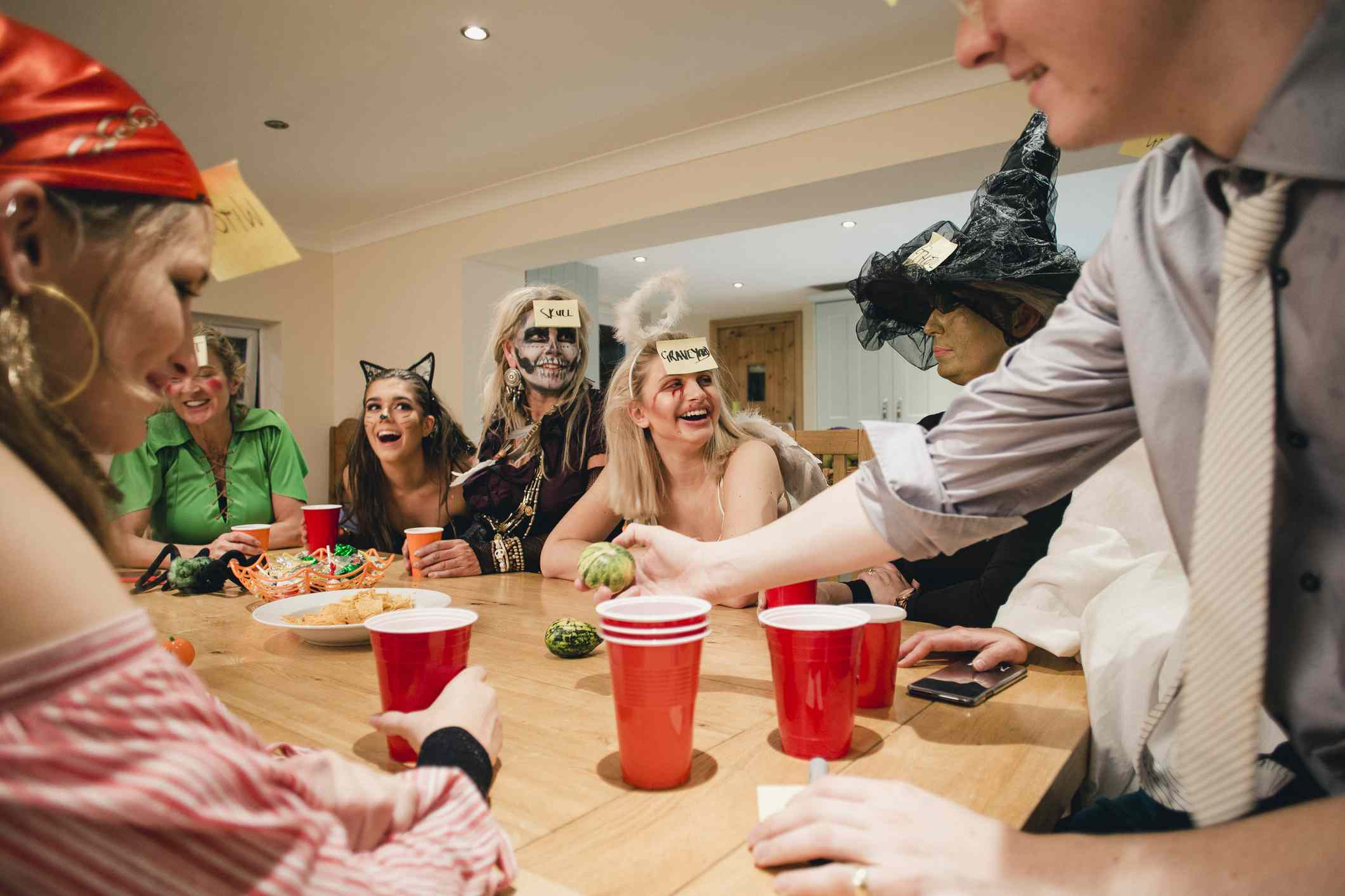 adults playing a Halloween party game