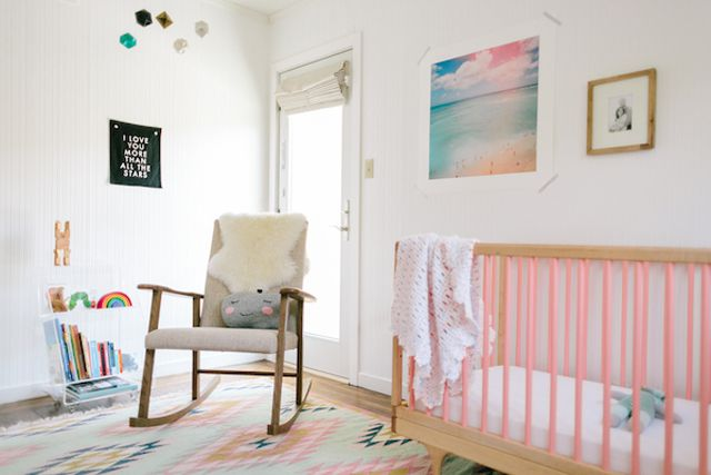 Minimalist nursery design with pink accents