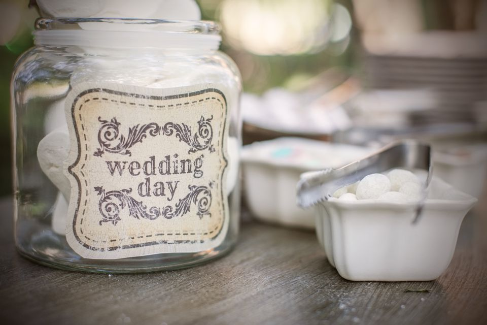 Sweets in glass jar with wedding day written on it