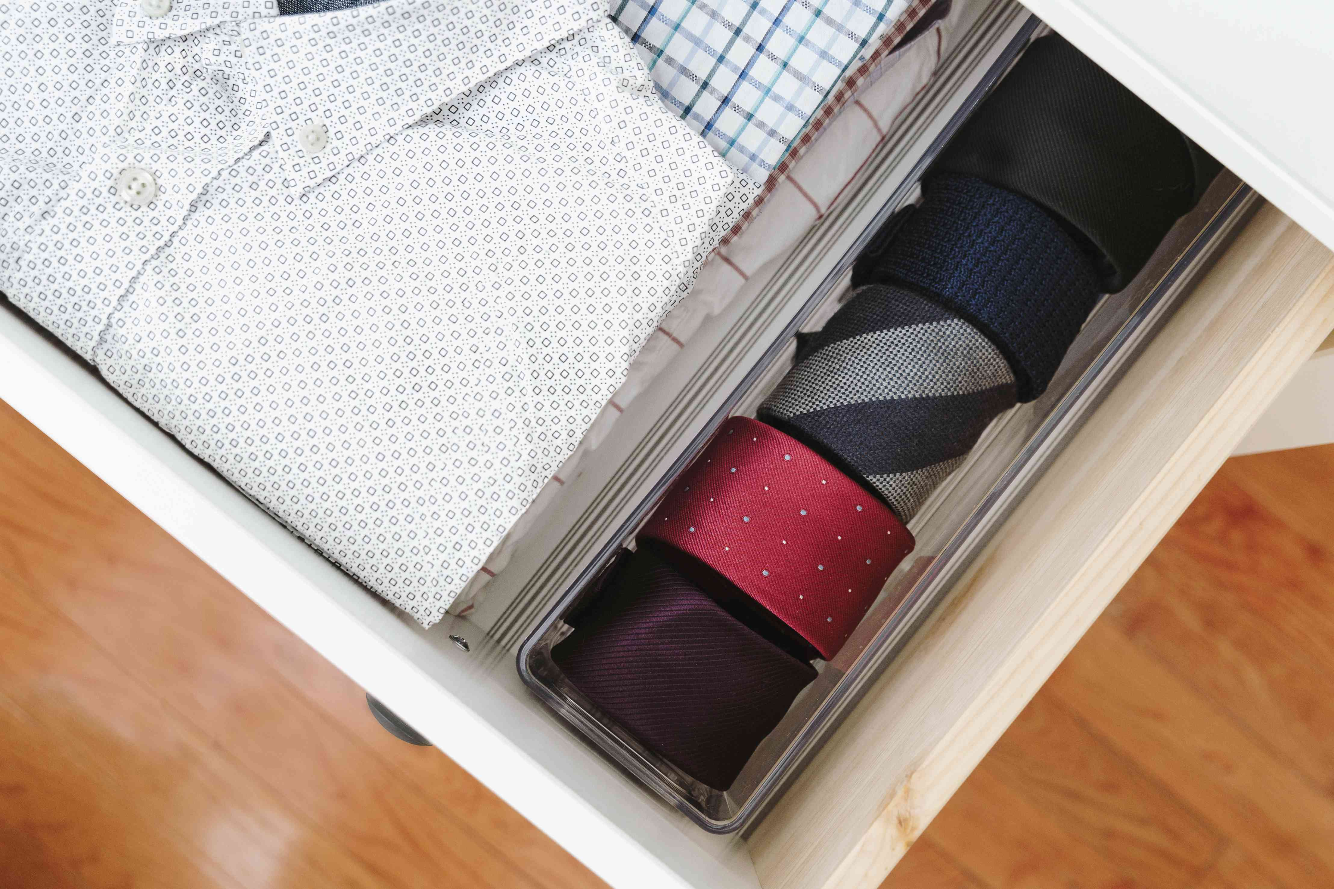 rolling up neck ties in a container
