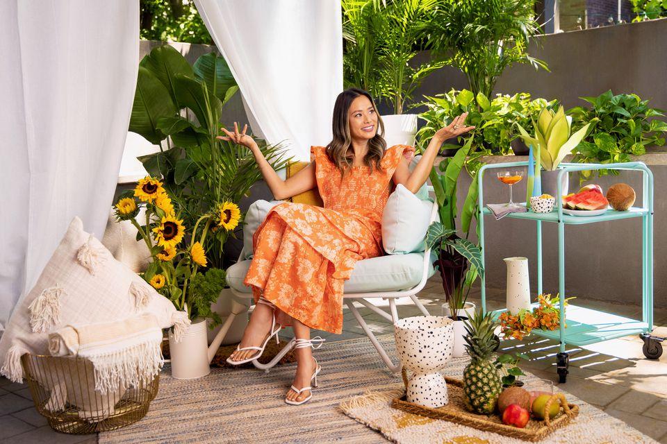 Actress Jamie Chung poses in her Brooklyn backyard