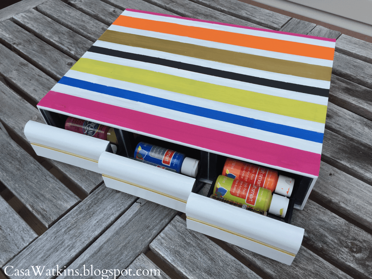 upcycled cassette tape holder used to store puffy paint