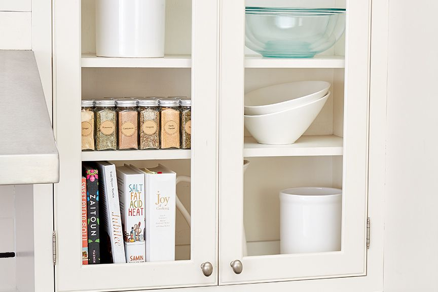 mixing bowls in an upper cabinet