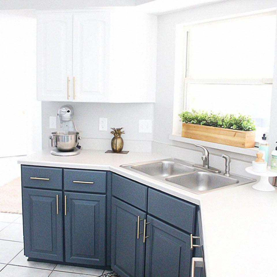A White kitchen with dark blue cabinets