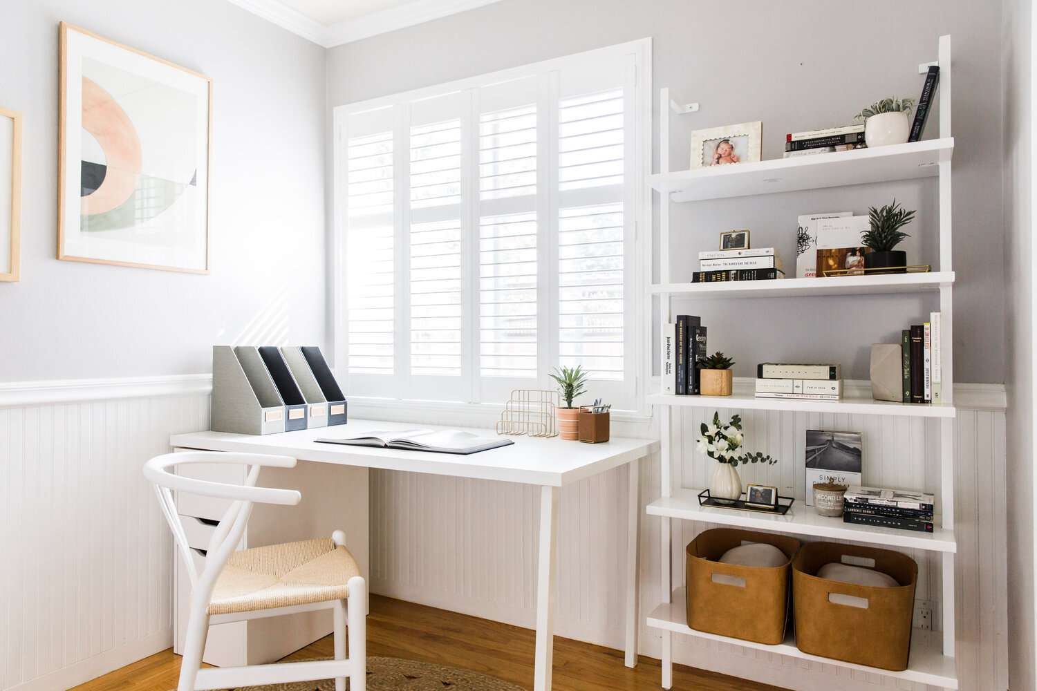 modern room with white table desk set up in the corner