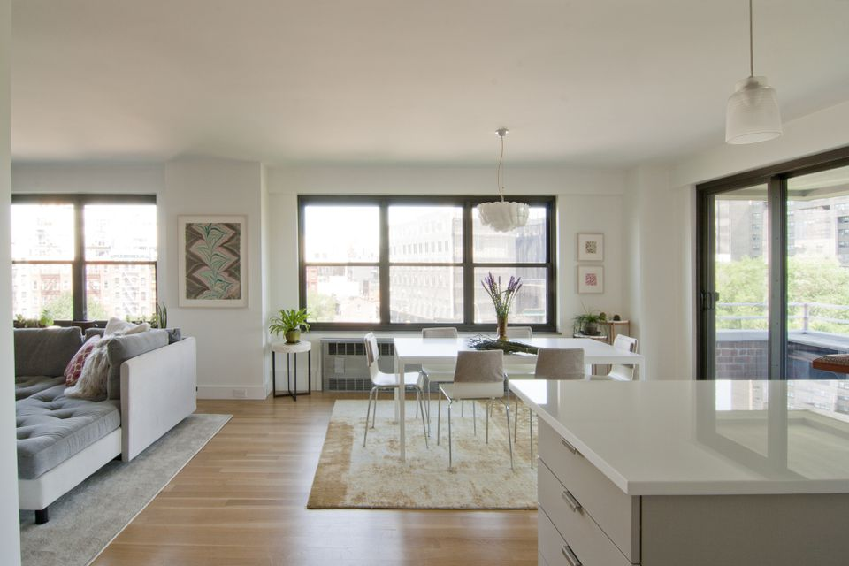 Peaceful neutral colored living room and dining room