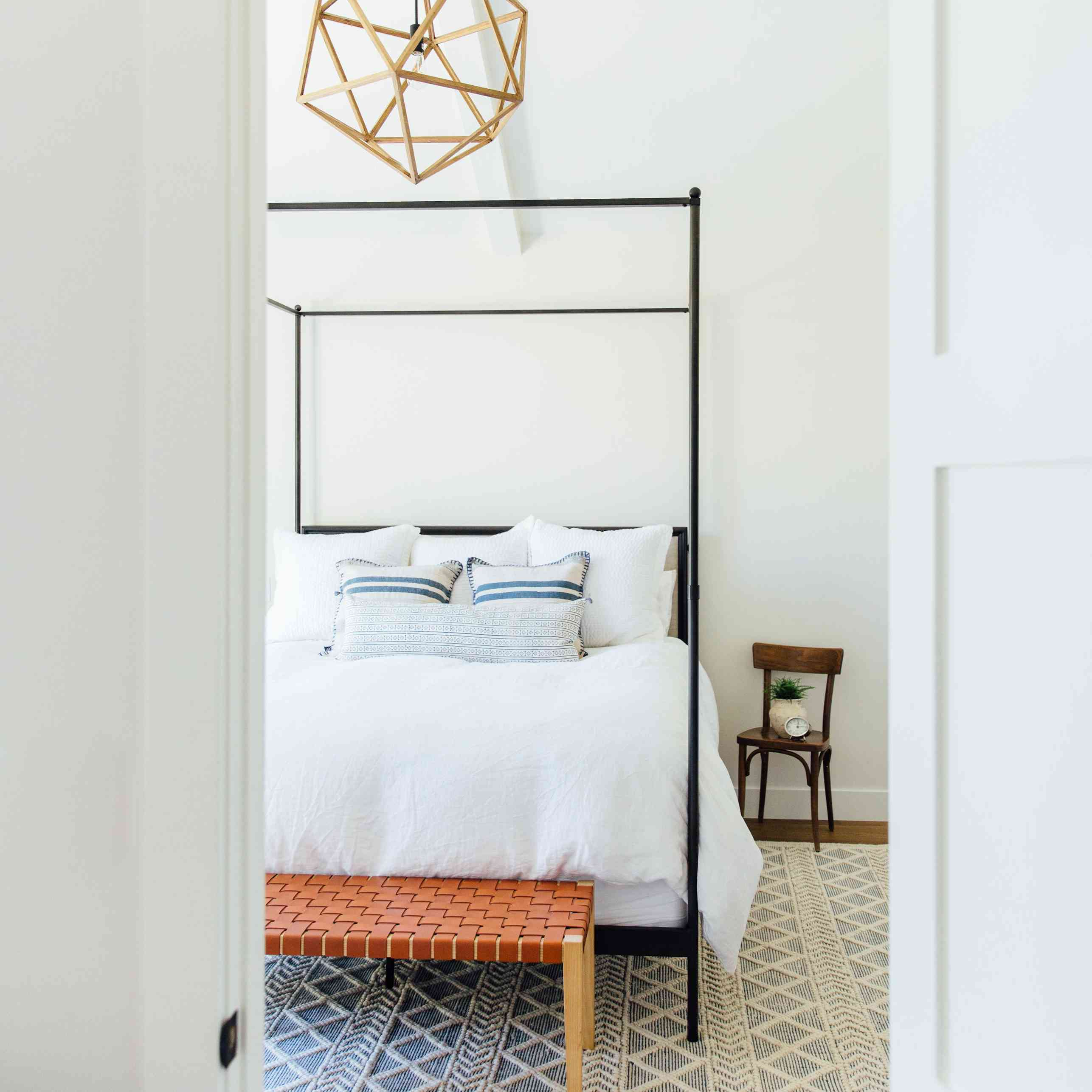 Beautiful white bed by Michelle Lisac Interior Design