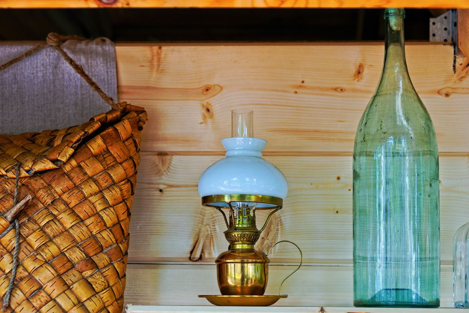 An oil lamp and a glass bottle