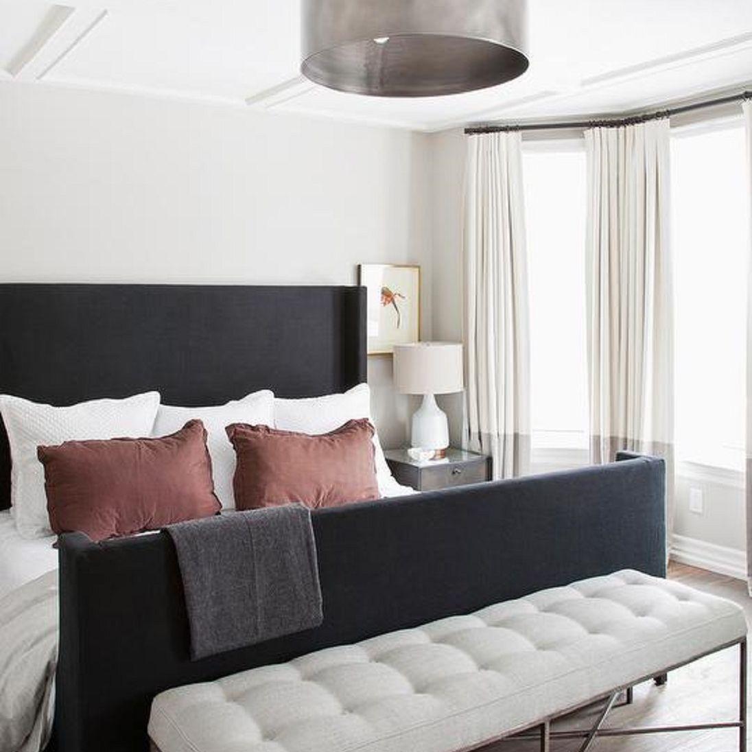 Bedroom with metal semi-flush-mount light fixture.