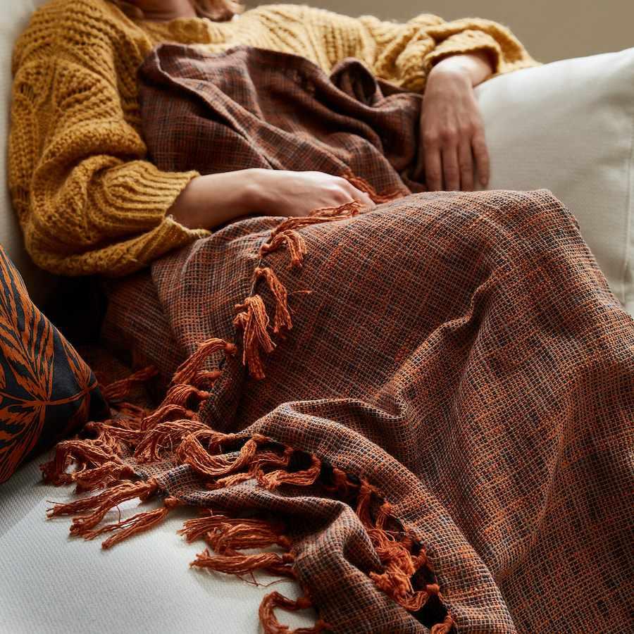 An orange throw blanket
