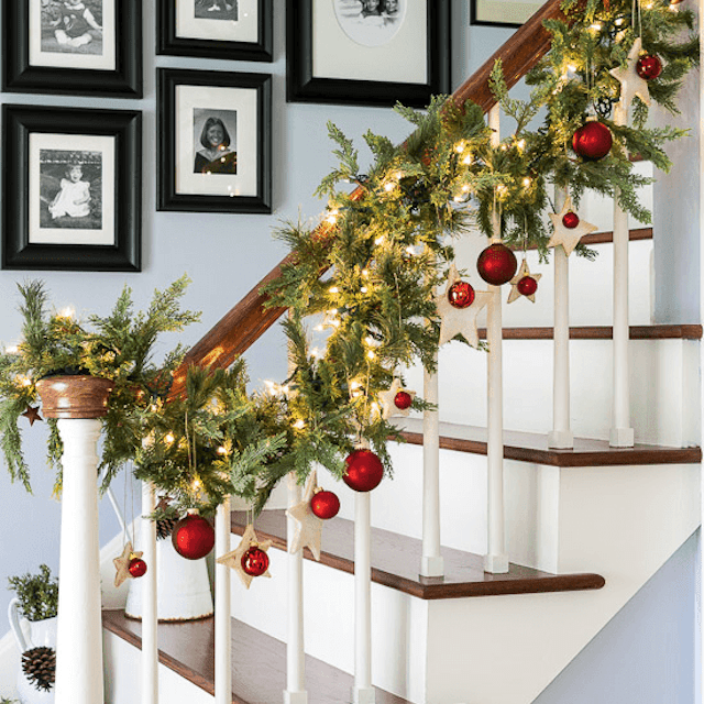 banister with garland on it - How To Decorate Stairs For Christmas