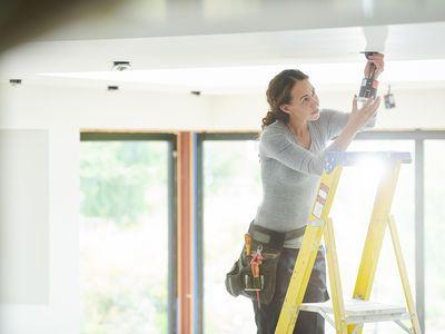 Woman Installing Recessed Lighting