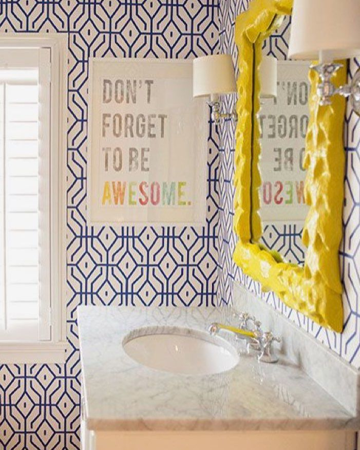 Blue and yellow kids' bathroom with patterned wallpaper