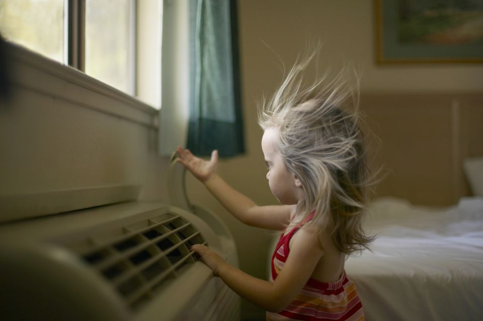 Toddler (21-24 months) feeling air coming from room airconditioner
