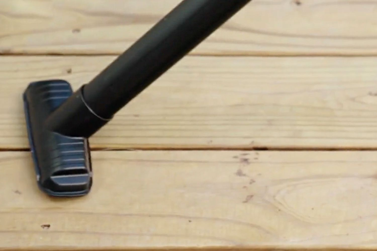 vacuuming the wood before staining or sealing