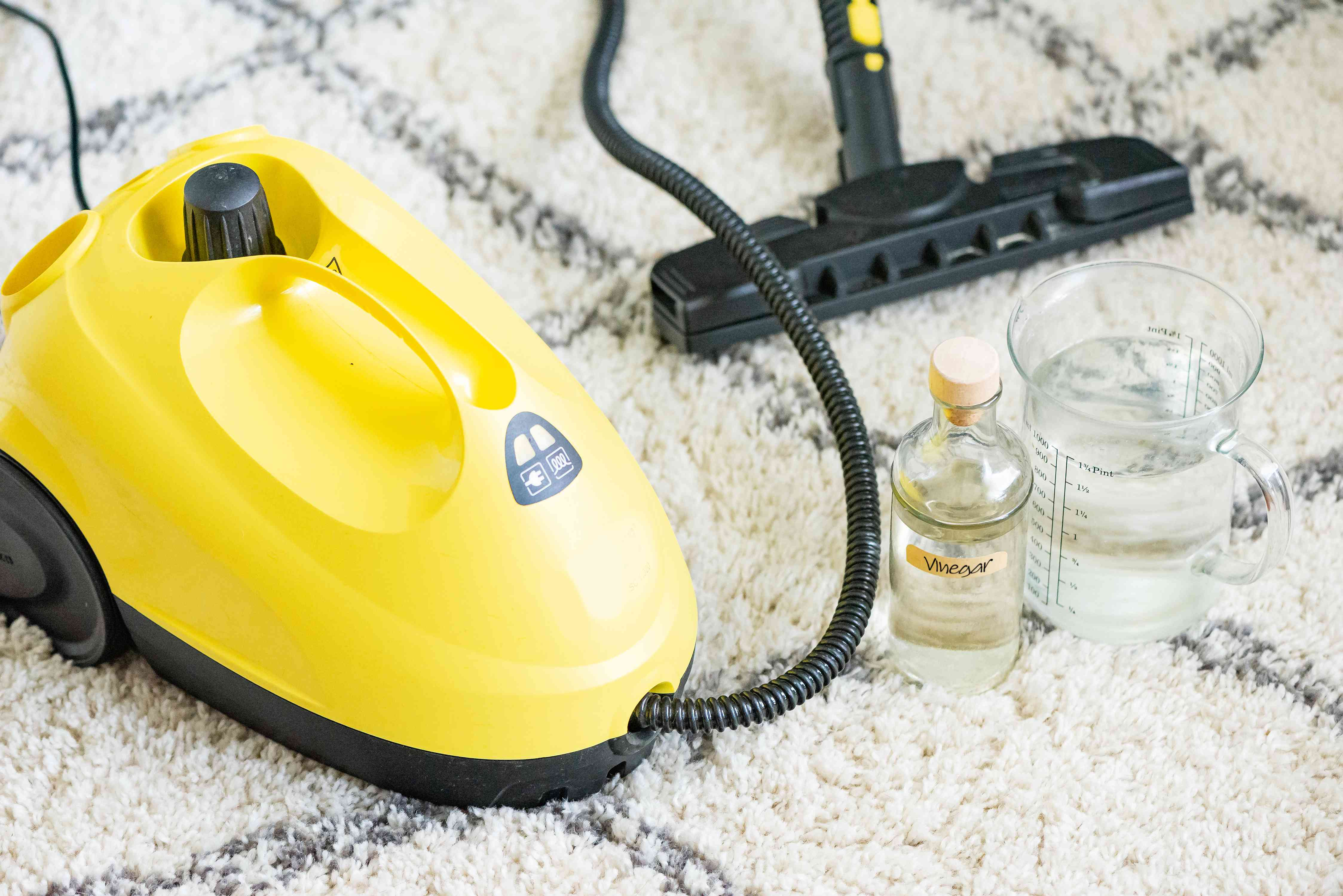 using a steam cleaner on a carpet