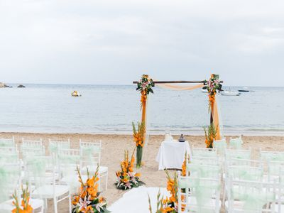Chairs and wedding arbor on a beach