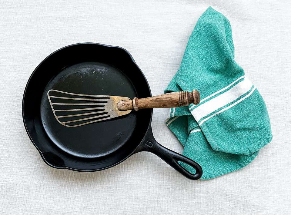 Cast iron pan with towel and spatula