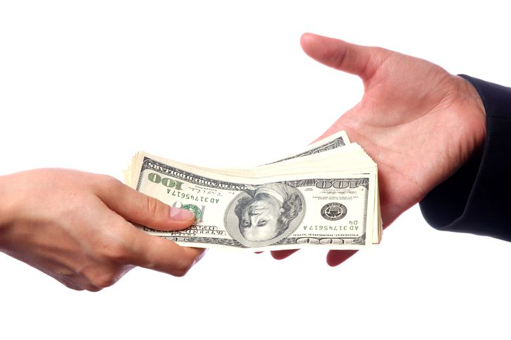 Hands exchanging dollars/easy money