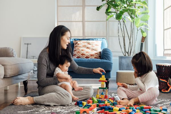 Mother playing with children in the living room