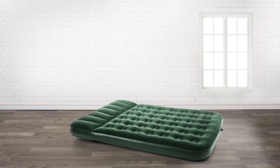 Air mattress in an empty room