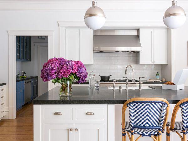 Bright white kitchen with chrome lighting