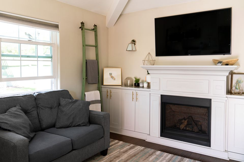 Flat screen tv mounted to wall above fireplace