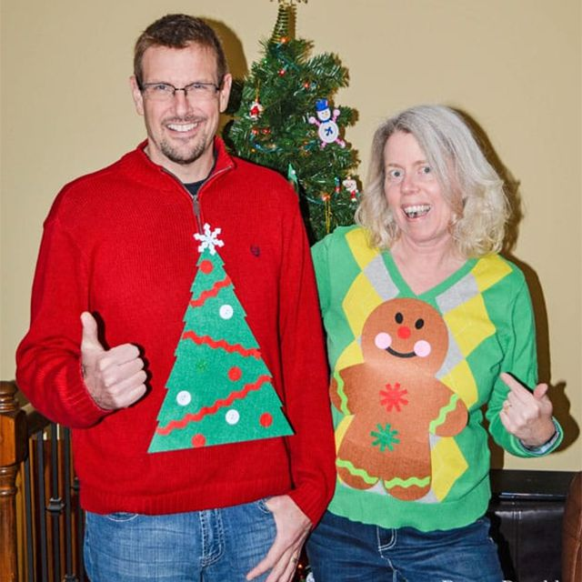 A couple wearing ugly Christmas sweaters