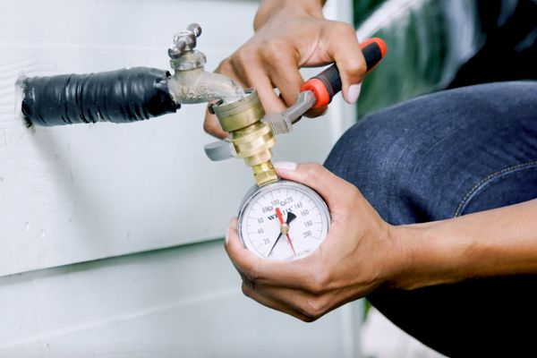 person checking water pressure