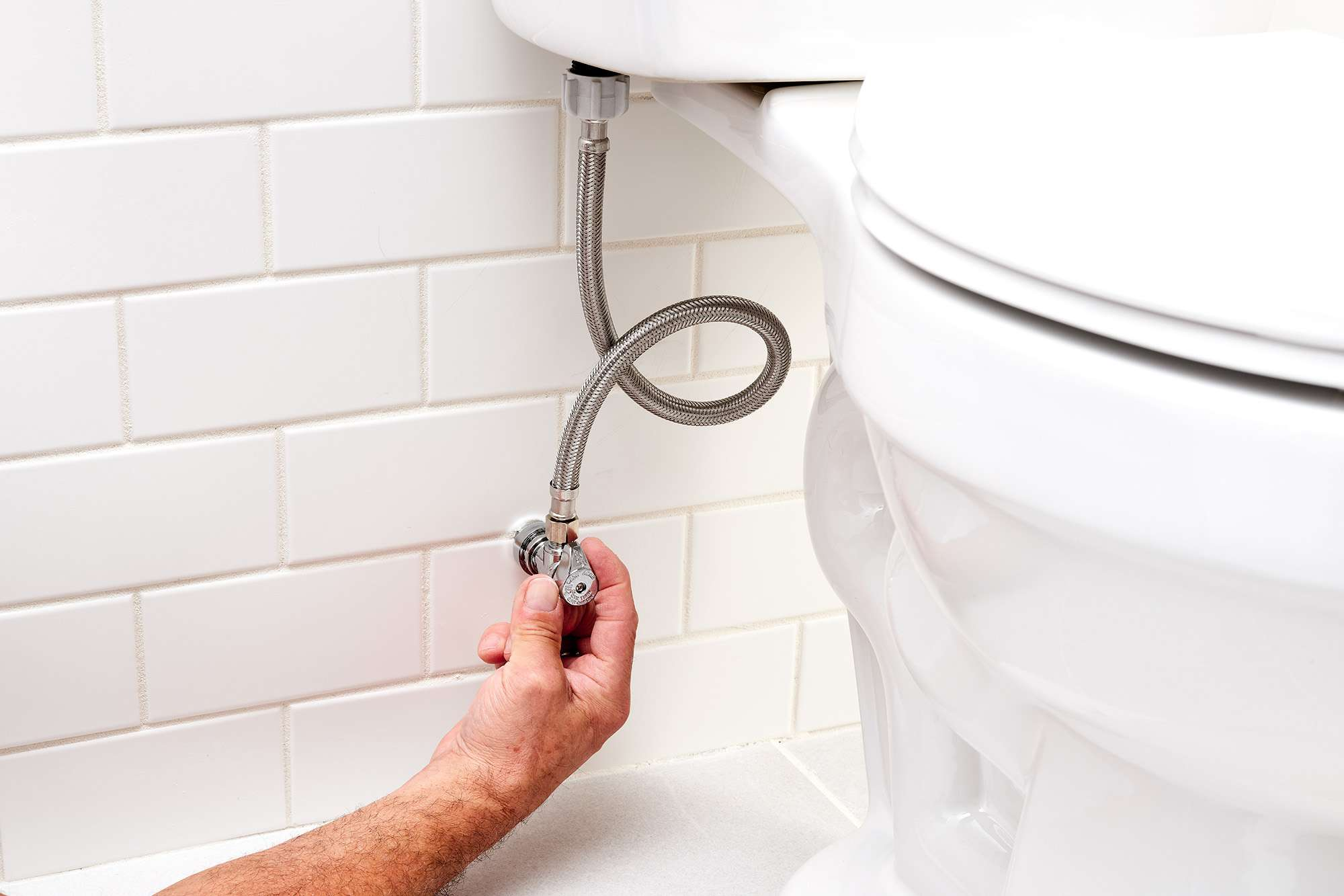 Shutoff valve handle turned to refill and test toilet