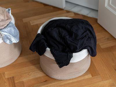 dark clothing in a hamper