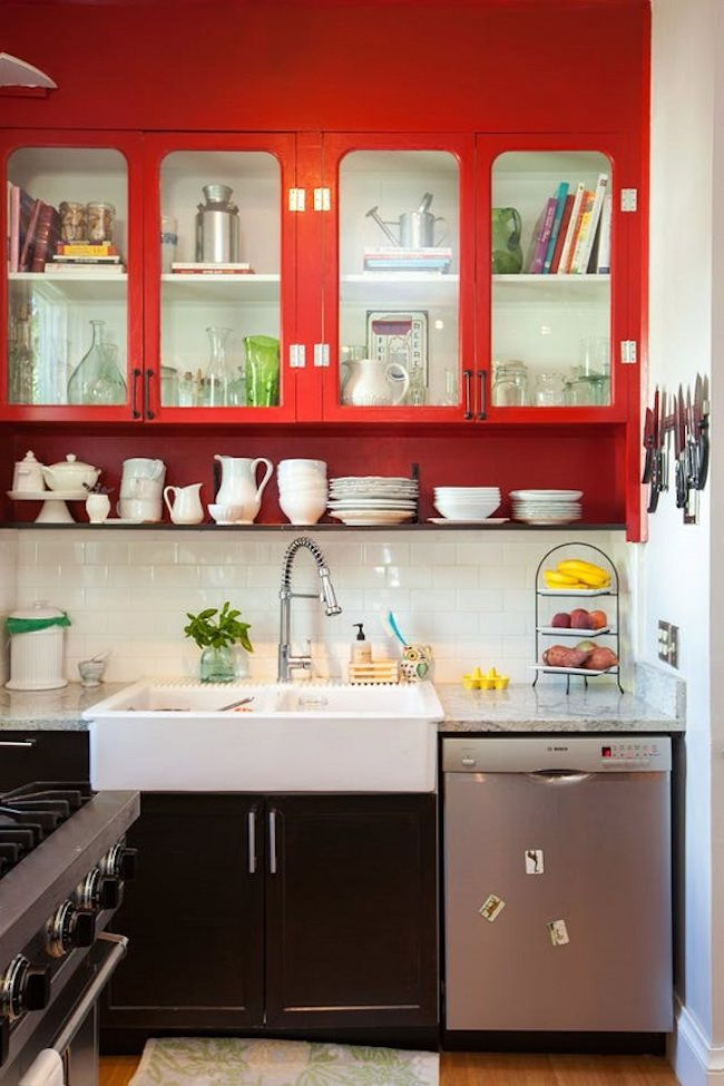 modern type kitchen with red top cabinets