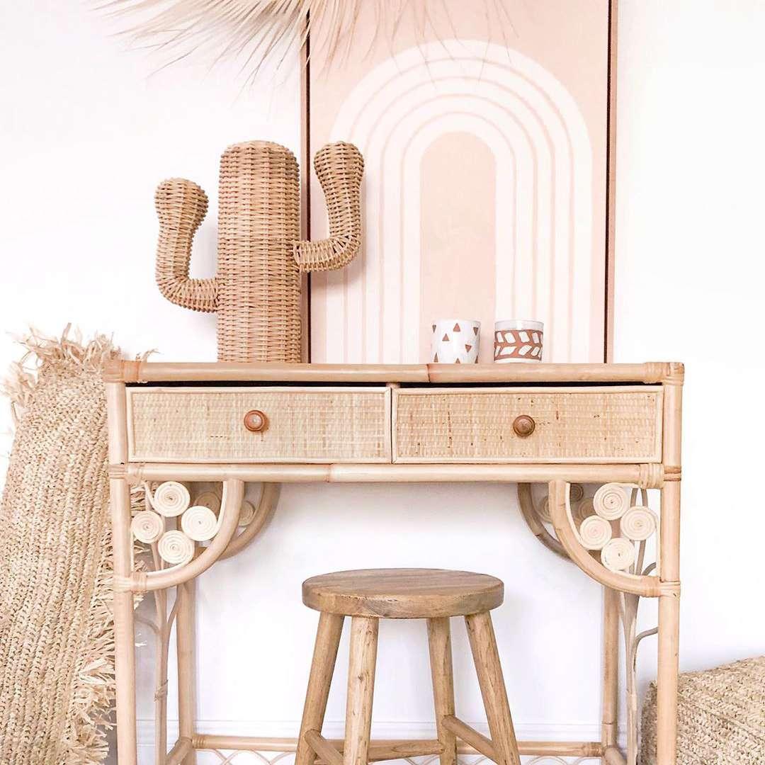 Desk with pink artwork