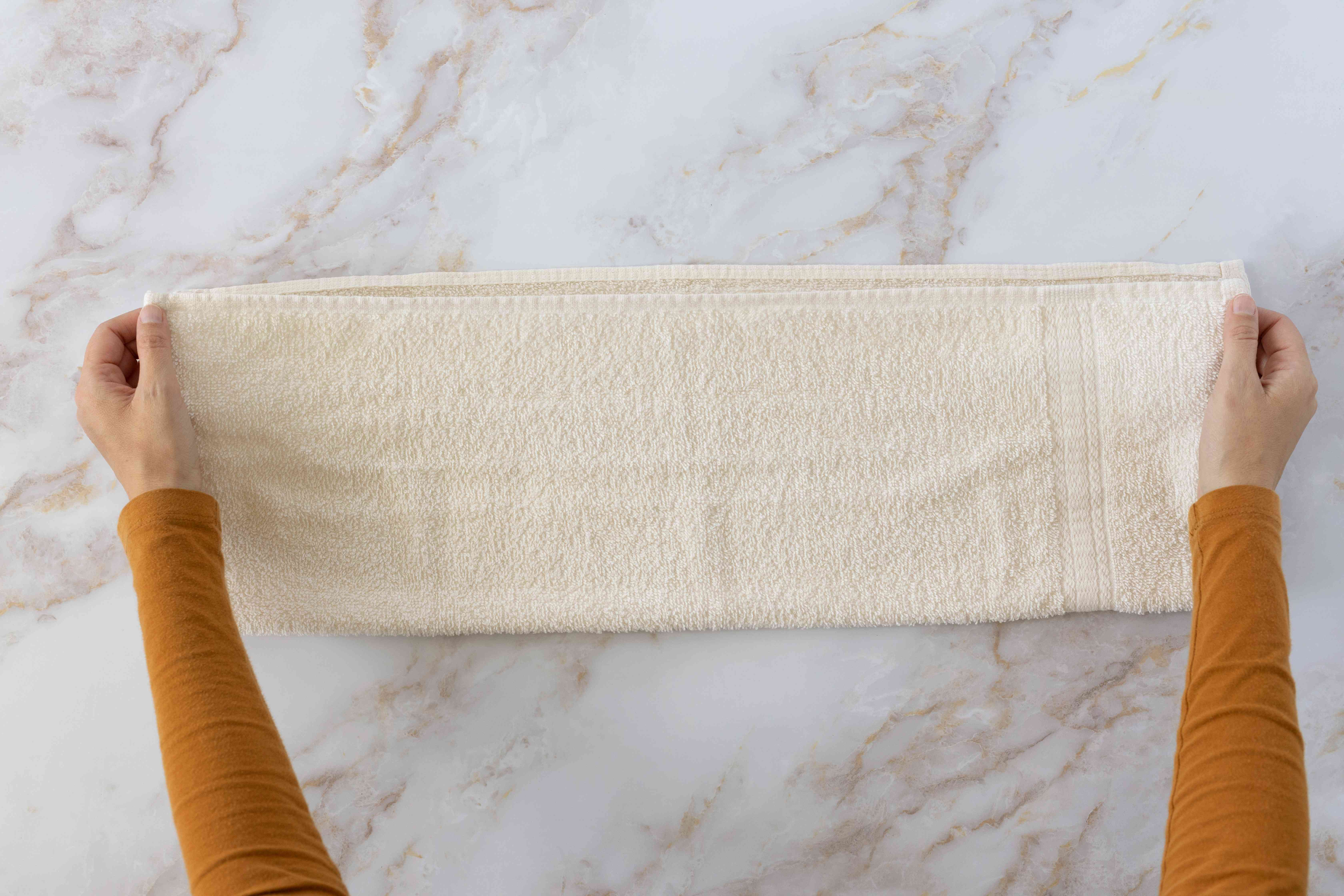 Cream towel folded in half long ways