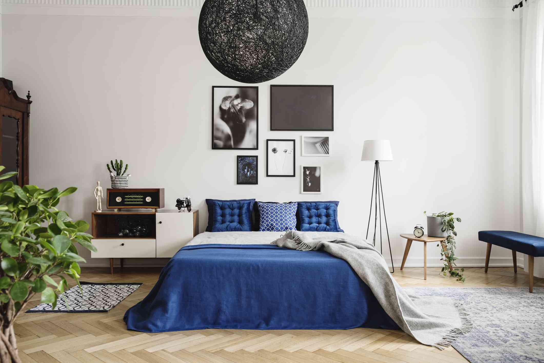 black chandelier in a blue and white bedroom